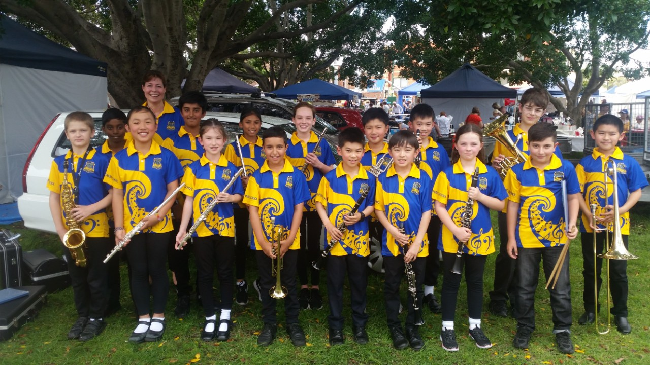 School band members in their colourful music themed shirts.
