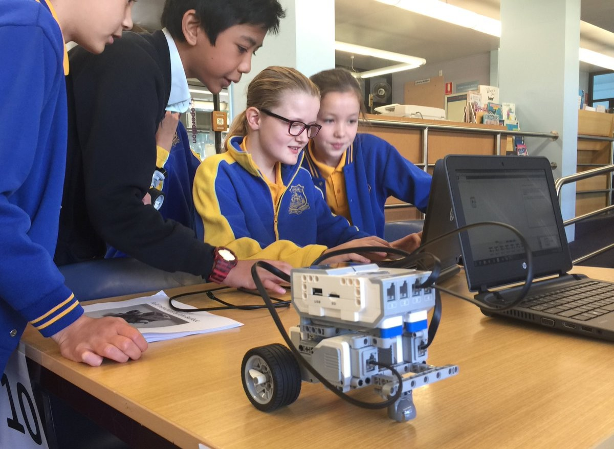 Students working with robots in class.